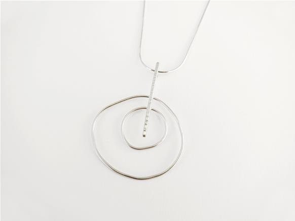Double uneven circle pendant in sterling silver