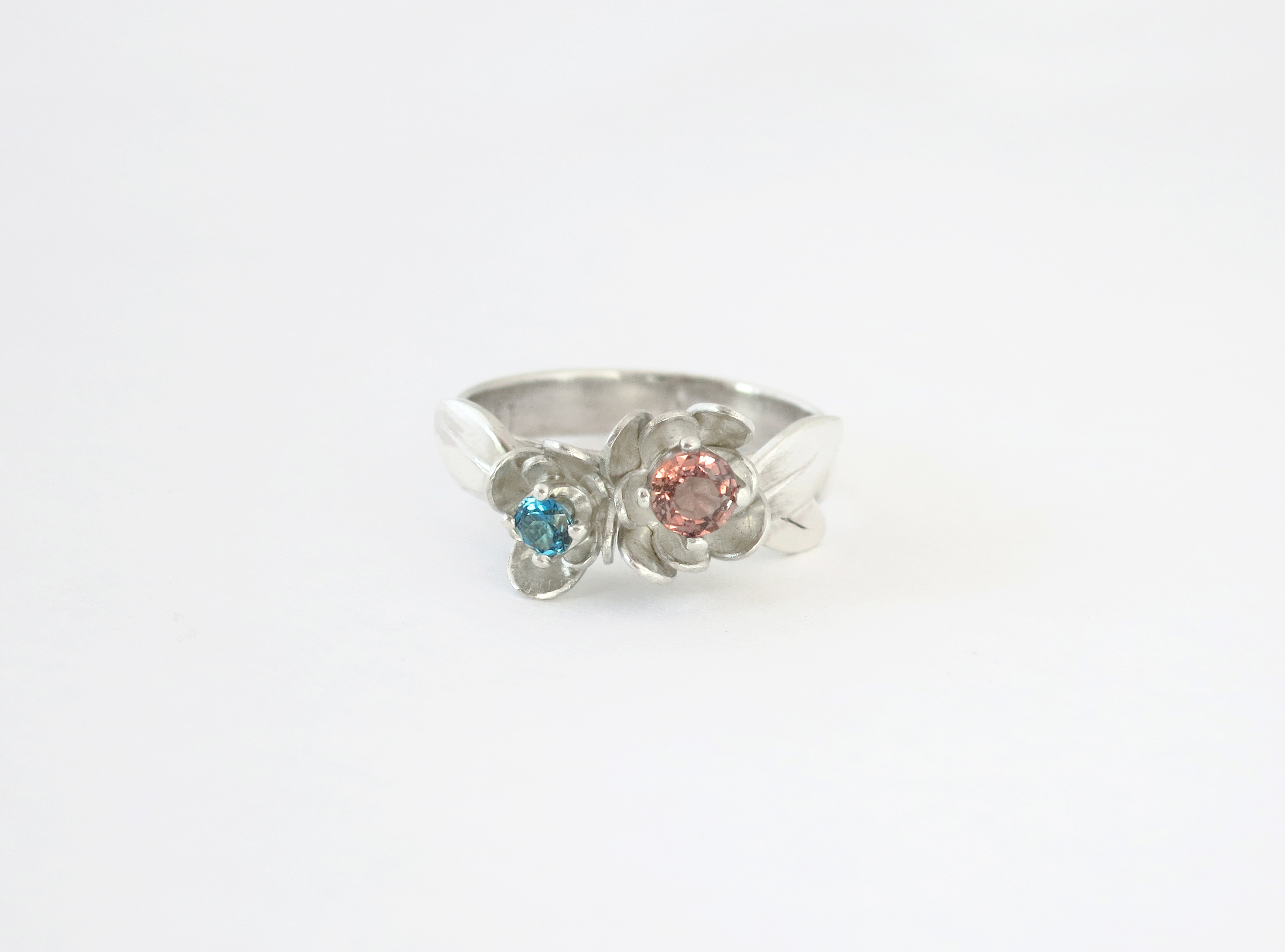 Engagement flower ring in sterling silver with pink sapphire and blue topaz